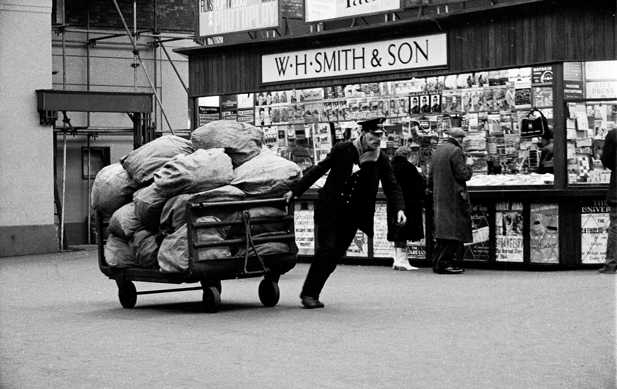 AT THE SEASIDE - Porter Pulling Barrow - Brighton Station - 1959